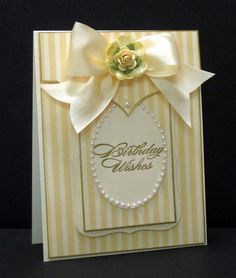 Stamps: SU Bring On The Cake   Paper: Paper Cpmpany Ivory Stripe   Ink: Versamark   Accessories: Ranger Gold Embossing Poweder, Gold Leaf Pen, Tim Holtz ornate Die, Spellbinders Oval and label Die, May Arts Silk Ribbon, Prima Flower, Pearls