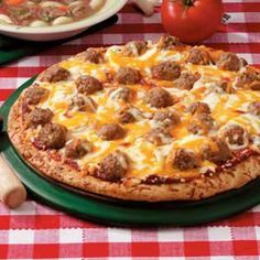 """Meatball Pizza Recipe- Recipes """"I always keep meatballs and bread shell crusts in the freezer to make this pizza at the spur of the moment,"""" says Mary Humeniuk-Smith of Perry Hall, Maryland. """"Add a tossed salad and you have a delicious dinner. Meatball Pizza Recipes, Beef Recipes, Cooking Recipes, What's Cooking, Hamburgers, Quesadillas, Empanadas, Quiche, Cheese Crust Pizza"""