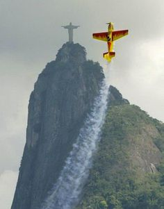 A stunt plane does its best impression of Christ the Redeemer.