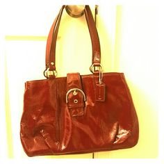 Red coach over the shoulder bag Red over the shoulder back with tan inside. Used twice. Coach Bags Shoulder Bags