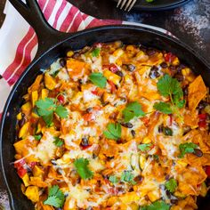 One Pot Stove Top Enchiladas - Summer Style Recipe Main Dishes with olive oil, corn tortillas, yellow onion, zucchini, yellow squash, red bell pepper, garlic, corn kernels, black beans, salt, black pepper, ground cumin, paprika, grating cheese, enchilada sauce, cilantro leaves