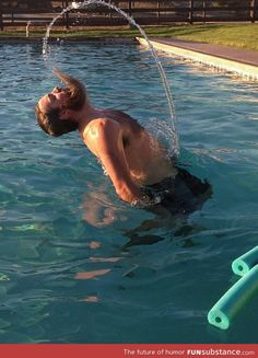 Manly version of water hair flip. So majestic.