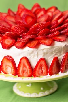 Easy Strawberry Cake with White Chocolate Cream Cheese Frosting Recipe using White Cake Mix, Frozen Strawberries, Strawberry Cream Cheese, Heavy Whipping Cream, White Chocolate, Cream Cheese, Frozen Whipped Topping, and Fresh Strawberries