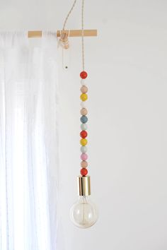 DIY Lighting Wooden Bead Pendant Light is part of Diy pendant light - Create your own custom lighting with colors to match your decor with this DIY wooden bead pendant light project!