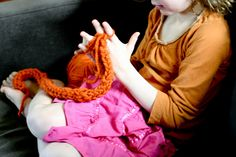 Finger Knitting    My girls each made a scarf in less than an hour.