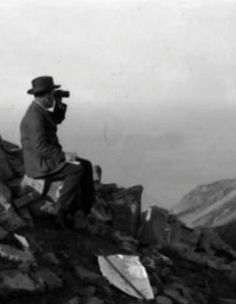 Commemorating Gallipoli's Hellenic Heart: Lemnos 1915. George Renwick, with binoculars and maps, watching the movement of Allied Shipping in Mudros Harbour from Mt Elias, Lemnos.