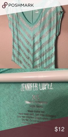 Jlo Teal Top Jennifer Lopez teal top with chevron silver print. Super cute and forgiving in mid area. Long open sleeves Jennifer Lopez Tops Blouses