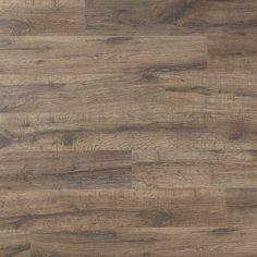 The perfect hue for a dining room. Heathered Oak Planks, laminate flooring by Quick•Step.
