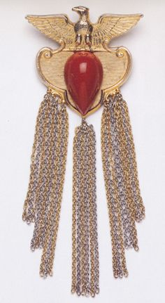 As a collector of Americana pins, Madeleine says that she has enough eagles to comprise a flock!  On the day of the announcement by President Clinton nominating her as sixty-fourth Secretary of State in 1996 Madeleine wore a large Eagle pin clipped in the center of her pearl strand, the eagle held a pearl in its claws.   January 20, 2001 was the last day that Madeleine Albright was Secretary of the State and on her final day she chose to wear the Trailing Eagle pin for the official cabinet…