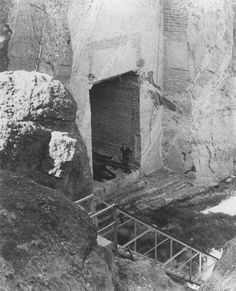 """This is a picture of the entrance to what was to have been the """"Hall of Records"""" in a crevice immediately behind Mt. Rushmore. The actual Hall of Records was never completed as envisioned but this 50-foot tunnel remains. This photo was taken in the late 1930s. In 1998 the Mt. Rushmore Historical Society succeeded in having a small cache of records placed in a scaled down version of the hall."""