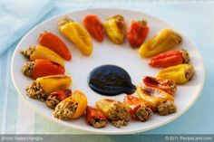 These cute and fresh baby peppers are stuffed with a mixture of ricotta cheese, toasted walnuts, sun-dried tomatoes, basil pesto and black olives. Roast them in the oven, they come out cheesy, oozy and absolutely tasty. Serve these cute yet yummy peppers as an appetizer that everyone will love and enjoy.
