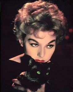 Kim Novak and Pyewacket in a production still from Bell, Book and Candle (Richard Quine, 1958) via 20th-century-man