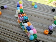 Pony Bead Camp Bracelet    This fun project is great for almost any age. Working with beads is fun and this method is very easy.