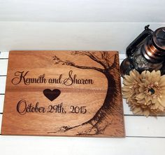 1)Description: This Large Beautiful Mahogany Cutting Board is hand made and custom engraved. It will make the PERFECT gift for anyone on your list. The boards are treated with Food Grade Oil.  2) Personalizing Your Order: During check out there will be a note to seller box. There you can enter all the information you want on your personalized ornament.In the note to seller box at checkout I will need: 1. The First Names 2. The date to be engraved 3. The date of requested delivery. Please…