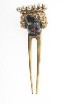 Enfant (tête), designed by Elsa Schiaparelli (produced by Jean Schlumberger). gold metal, glass beads, enamel Circa 1936-1939. Les Arts Décoratifs, Paris.