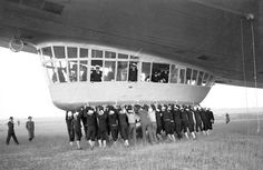 Hindenburg - A ground crew helps with a landing a year before the disaster. May 9, 1936