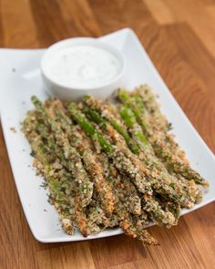 INGREDIENTS1 bundle of asparagus1 cup crushed almonds*⅓ cup parmesan1 tablespoon garlic powder2 tablespoons dried oregano1 teaspoon salt1 teaspoon pepper2 eggsPREPARATION1. Preheat oven to 425°F/220°C.2. Cut off about 1-2 inches of asparagus ends. Set aside. 3. In a large bowl combine crushed almonds, parmesan, garlic powder, oregano, salt, and pepper. 4. Whisk eggs in a shallow bowl or dish. 5. Dip asparagus in eggs, coating evenly, and then toss with the bread crumb mixture. 6. Place on a…