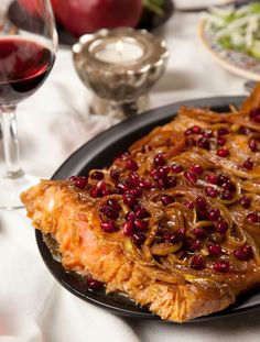 Pomegranate Salmon Made for Rosh Hashana. Was yummy and pretty. The fish did not have as much of the flavor as I wanted but when you had it with the onions it was perfect.
