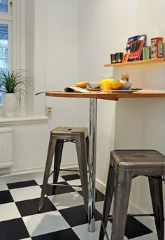 proof that breakfast bar's needn't be big: small round, stacking stools, useful shelf. drop-leaf table alternative?