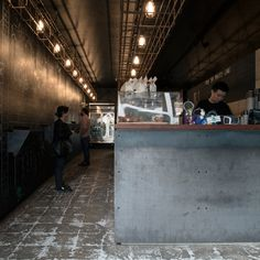 Architect Louise Nettleton has shoehorned a comic-themed coffee shop into a narrow gully formerly used as a driveway near Sydney's Central Station