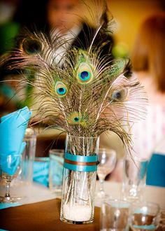 peacock feather centerpieces or flowers with peacock feathers? Just feathers would be cheaper, but I also think it'd be a little more frou frou. - Wedding Day Pins : You're Source for Wedding Pins! Peacock Wedding Centerpieces, Diy Centerpieces, Our Wedding, Dream Wedding, Wedding Stuff, Wedding Wishes, Jazz Wedding, Wedding Photos, Wedding Simple