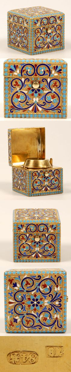 A Russian silver gilt and cloisonne enamel traveling inkwell, Gustav Klingert, Moscow, late 19th century. The sides and hinged lid worked in a multi-color scrolling foliate motif within borders of turquoise enamel beads. The gilt interior fitted with a spring-loaded cap an container for ink.