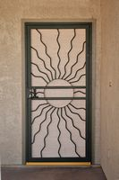 First Impression Security Doors (http://www.firstimpressionsecuritydoors.com) produces custom high quality iron security screen doors - this Southwest style is called Aura