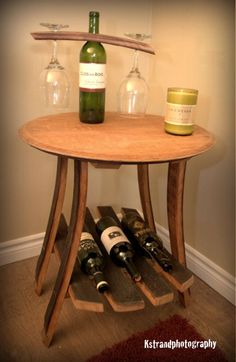 End table uniquely made from wine barrel stave and the barrel head.