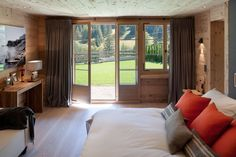 Chalet Gstaad, Switzerland by Ardesia Design. #Chalet #interior #design #architecture #bedroom #patio #decorator #custom #made #bedlinen #wooden #floor