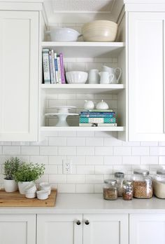 open shelves, touch of wood for warmth, white subway tile with light gray grout, subway tile extending behind open shelves