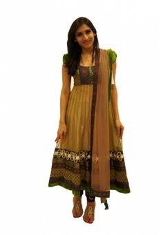 Nude Green    This anarkali is a perfect amalgamation of experimented prints, fabrics and textures. This nude shade dress is highlighted perfectly with assorted silk prints and trimmed with green velvet border. The pearl, zardozi border adds texture. It's perfect for any Indian occasion.    For more,  http://www.czari.in/women