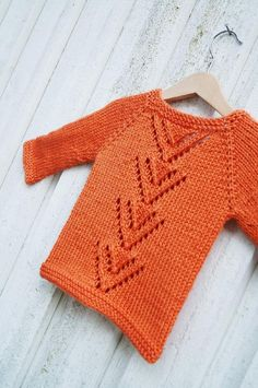 """Hopp, meaning """"hope"""" in Swedish, originally available in adult sizes, is now also available in baby and child sizes!The cardigan is worked top down, making it completely seamless, and features decorative lace along the back and at the end of the long sleeves. A crocheted button band is added when you've finished knitting the body. It's a definite eye catcher; time to show off!SizesNb-3m/6m/12m/18m/2y (4y/6y/8y/10y)The pattern has been test knitted in all sizes."""