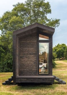 The Orchid Tiny House is New Frontier Tiny Homes' version of a contemporary farmhouse design Cabin Design, Tiny House Design, Minimalist House Design, Minimalist Home, Garden Cabins, Garden Sheds, Garage Door Styles, Tiny House Builders, Little Houses