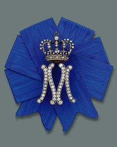 A LADY-IN-WAITING BADGE FOR QUEEN MARIA JOSE OF ITALY, BY MUSY. Designed as a diamond-set initial 'M' surmounted by a crown on blue silk ribbon, mounted in silver and gold, circa 1930, 7.6 cm. high, in original case with 'M' monogram. Alphabet Images, Alphabet Design, Royal Crown Jewels, Royal Jewelry, Initial M, M Letter, M Monogram, Lady In Waiting, Maria Jose