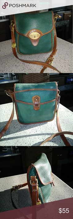 """DOONEY & BOURKE VINTAGE """"CAVALRY SCOUT"""" Dooney & Bourke Ivy Green Scout Cavalry Bag. pre tag era b4 Dooney started implementing their re/wht/blue registration tags. Dates to early 80's.  No stains or scuffs or flaws on the outside. Inside has several pen ink marks. Has the pre tag era fob attached. Measures 8in x 9in x 2.5 with approx 22in crossbody strap. A cutey in Ivy Green with british tan trim and solid brass hardware. Slip pkt  on back w tab closure. Inside has multi card slots and…"""