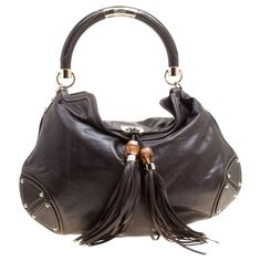 Hobo bags are hot this season! The Gucci Indy Dark Medium Top Handle Brown Leather Hobo Bag is a top 10 member favorite on Tradesy. Gucci Brand, Hobo Purses, Brown Leather Handbags, Gucci Handbags, Luxury Handbags, Dark Brown Leather, Hobo Bag, Diy, Fall