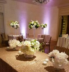 White wedding floral of peonies, hydrangea, calla lilies, orchids.  In bloom, ltd.