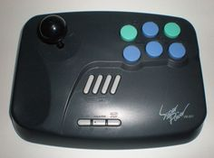 Superpower Arcade Joystick VB-001 :-: Made to be used with the SNES and Sega Genesis/Megadrive, this fine looking controller is made in the arcade deck style. All six buttons are independently configurable for turbo and auto fire. The deck of the controller has been molded into likely areas where ones hands might be placed for comfortable game play.