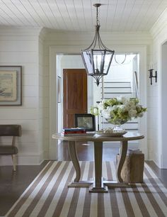 LOVE entrance, lighting, horizontal bead board, table, rug.....and on and on and on!