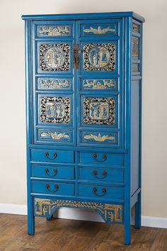 Statements by J: Hand carved cabinet in gold and blue
