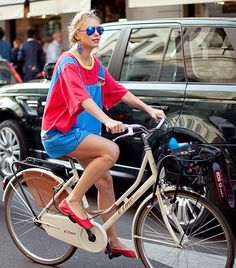 I need to start riding my beach cruiser with milk braids, aviators, statement earrings, and an oversized dress. What was I thinking?