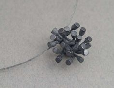 WC875  Flower bud pendant , multiple bud burst form - oxidised stg silver, stainless cable  $345