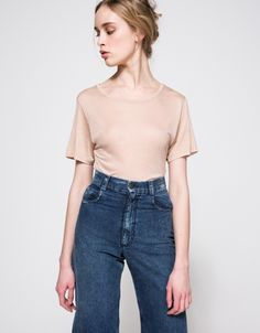 From Baserange, a lightweight bodysuit in heather Nude with classic styling.  Features wide round neckline, ribbed neckline, short sleeves, snap button rise, side panels and relaxed fit.  •Lightweight bodysuit in Nude •Wide round neckline •Ribbed n