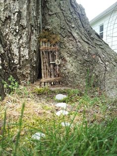 Fairy/elf door out of sticks, twine and misc. Hardware store accessories, added stones and moss from the yard for a homey touch!