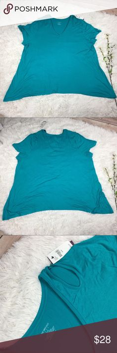 """LB teal cut out shoulder short sleeve top NWT teal short sleeve top from Lane Bryant. Size 26/28 flat measurements included are approximate bust 27"""" length 31"""". Features cut out shoulder design and handkerchief sides. Open to offers or bundle with any other item to save 20% instantly! Lane Bryant Tops Tees - Short Sleeve"""