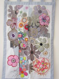 Flowers in gray and pink, Textile art, hand embroidered quilt OOAK.  via Etsy.