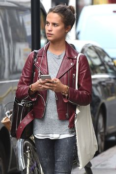 Jason Bourne Alicia Vikander Slim fit Biker Style Maroon Leather Jacket    Jacket Features:   Outfit type: Leather Jacket Gender: Female Color: Maroon Front: Front Zip Closure Collar: ShirtCollar Pockets: Two pockets