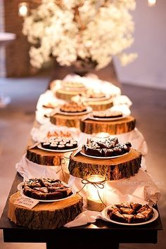 Love the wooden stands and the lighting. Could use candles or fairy lights. Would be cute to display food or for treats table