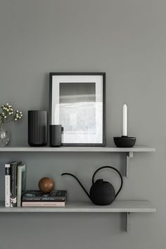 Dark grey walls with black accessories | Shelves painted the same shade as the wall blend in for a more minimalist look | black Lyngby porcelain vases