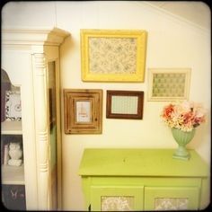 Frames and art can be expensive. Find old wood frames at thrift stores and paint them for a splash of color. Scrapbook paper makes for lovely and affordable art.